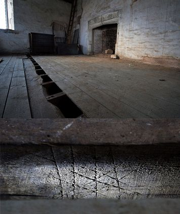 Upper King's Room, Knole House, England; Witchmarks beneath floorboards,  supposedly to keep away demons.