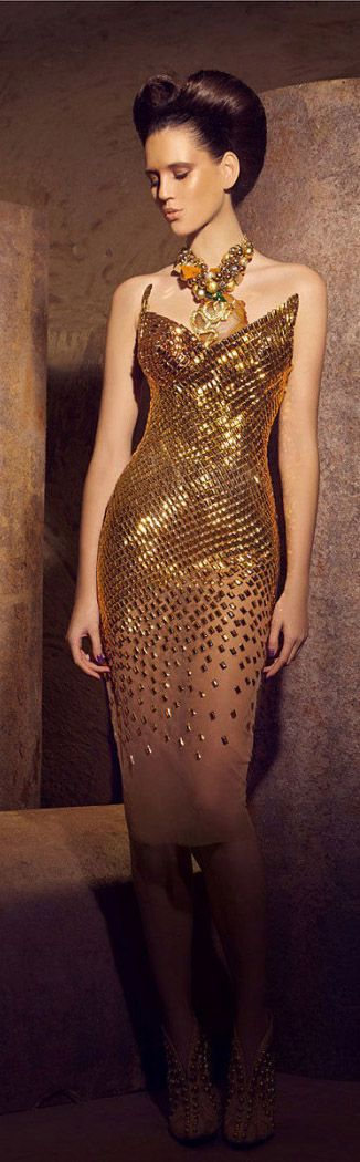 Mermaid costume inspiration. Love the fading gradient of scales to nude at the hemline. Nicolas Jebran - Gold Haute Couture