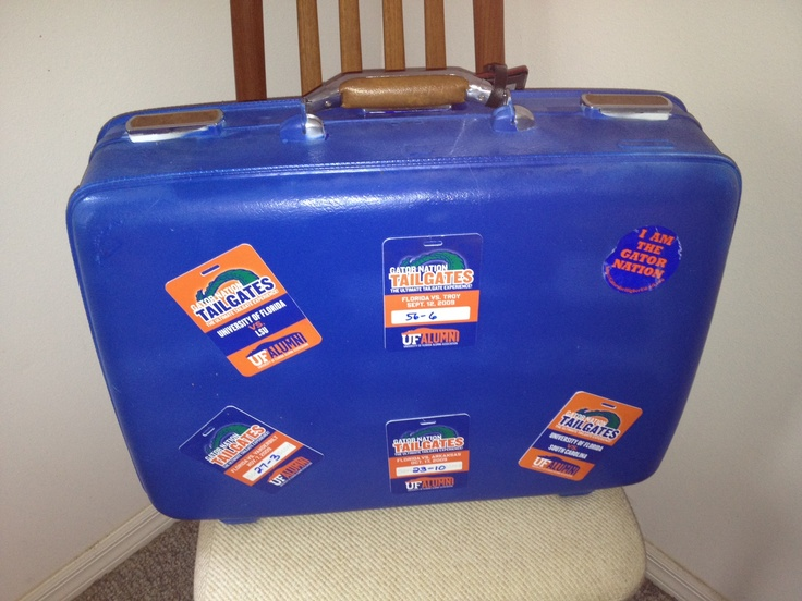 Backside of scrap suit case with tags from football games.
