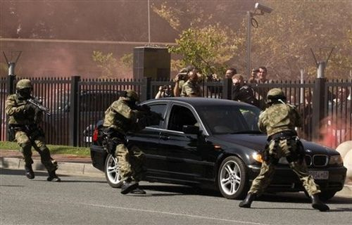 South Africa's police special task force point guns at a carjacker during a mock exercise showing the readiness of the security forces for the Soccer World Cup, in Johannesburg, South Africa, Monday, May 17, 2010. South African police say they are ready to provide adequate security for the football World Cup starting in June. The authorities have recruited and trained 44,000 new officers for the event, and bought new vehicles, water cannon and other equipment.