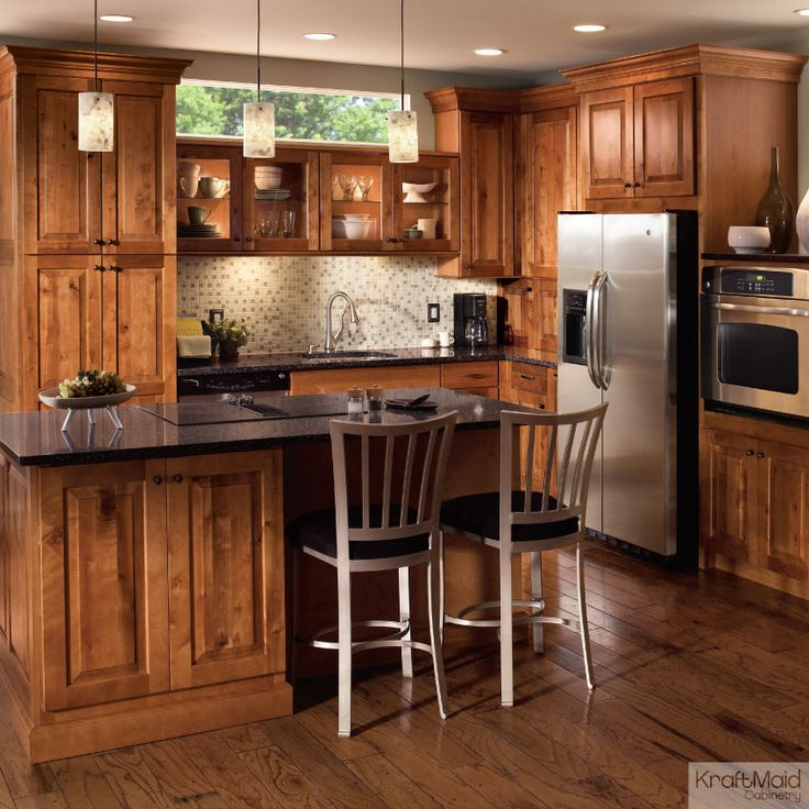 This rustic birch cabinetry with a praline finish adds a for Birch wood kitchen cabinets