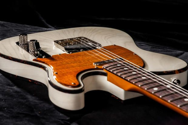 Memphis Guitar Spa Milk White finish on an Ash wood Telecaster body with a burnt orange stained flamed maple pickguard