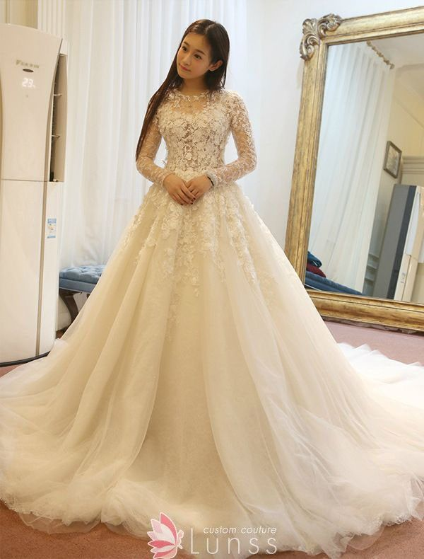 Gorgeous sequinned ivory lace and tulle winter wedding gown. Illusion  bodice with long sleeves. Chapel train. 47da17a0c0bb