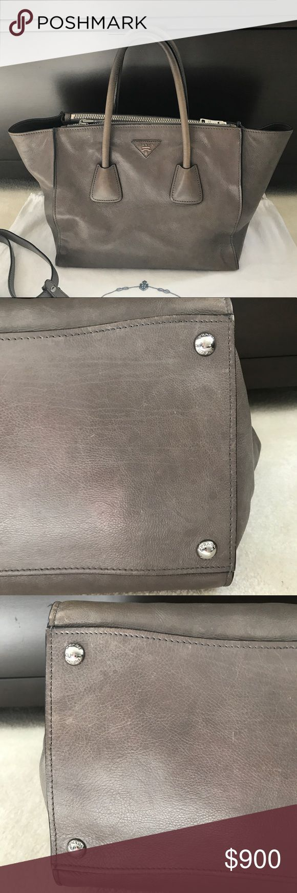 Authentic Prada Double Zipper Handbag ****PRICE DROP****Previously LOVED AUTHENTIC Prada Double Zipper Handbag. Leather shows signs of wear with a few scratches....inside is very clean. Measures approximate 12 x 6 3/4 inches and 10 inches tall.  All offers considered. Prada Bags