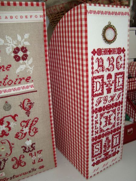 magazine cases covered in fabric or scrapbook paper with embroidered piece on outside edge.