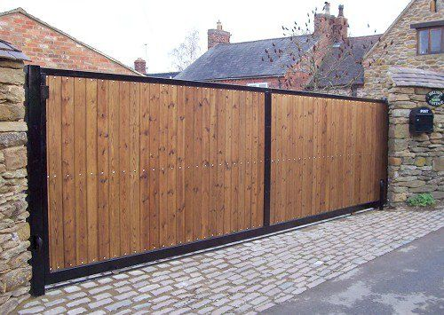 Steel framed timber clad automatic sliding gate                                                                                                                                                      More