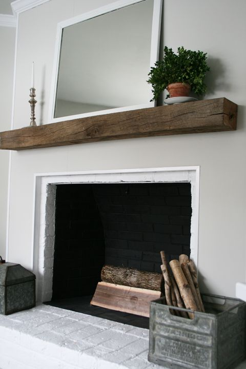 I love how adding a simple rustic beam as a mantel can add SO much to a fireplace.  This can't cost too much - maybe even use an old railroad tie from the lumber store?  My guess is this could be done for 200.00 or less?  Adds a lot of personality very simply.