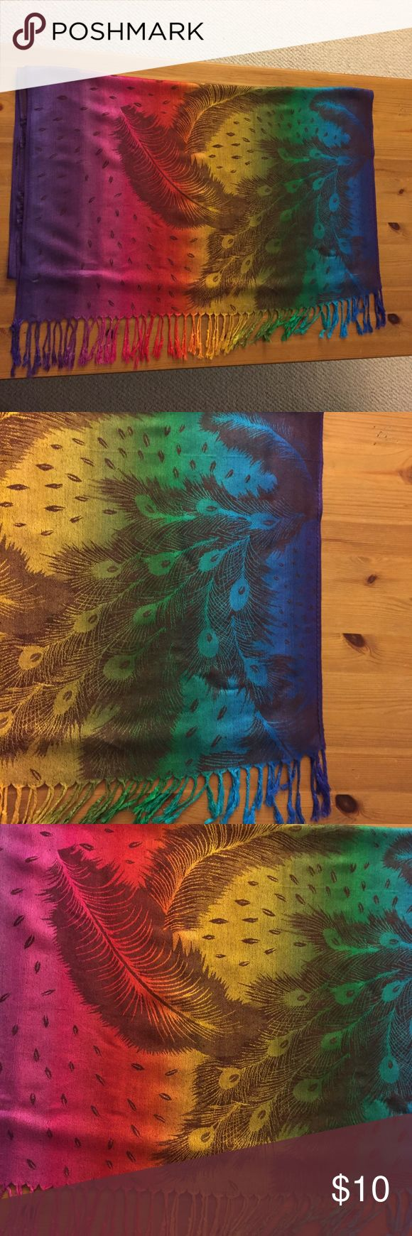 Rainbow Colored Scarf - Peacock Feather Print This colorful scarf is 100% Pashmina (goats wool). The fabric has peacock print with end tassles. It is 66 inches long and 27 inches wide. The scarf does not contain a tag but it has never been used. Unknown Accessories Scarves & Wraps