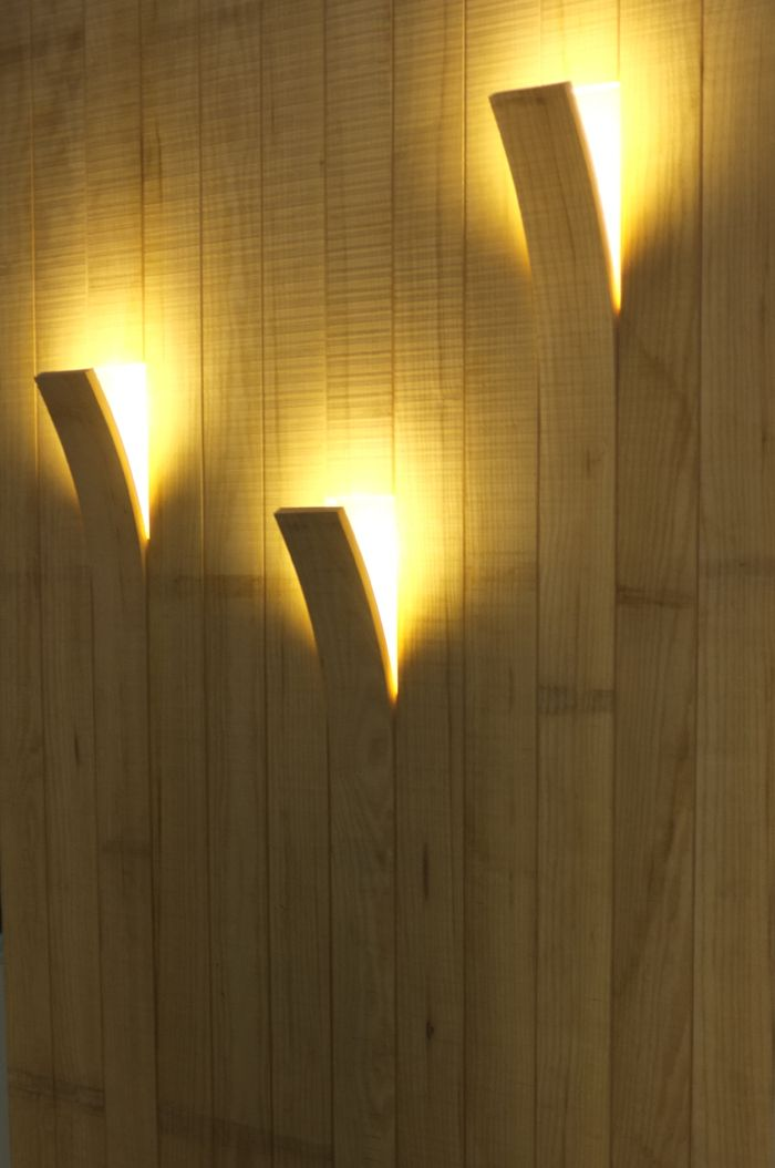 Smart indirect lights from Agence Daney, great way to save space in a small apartment while brightening up the room.