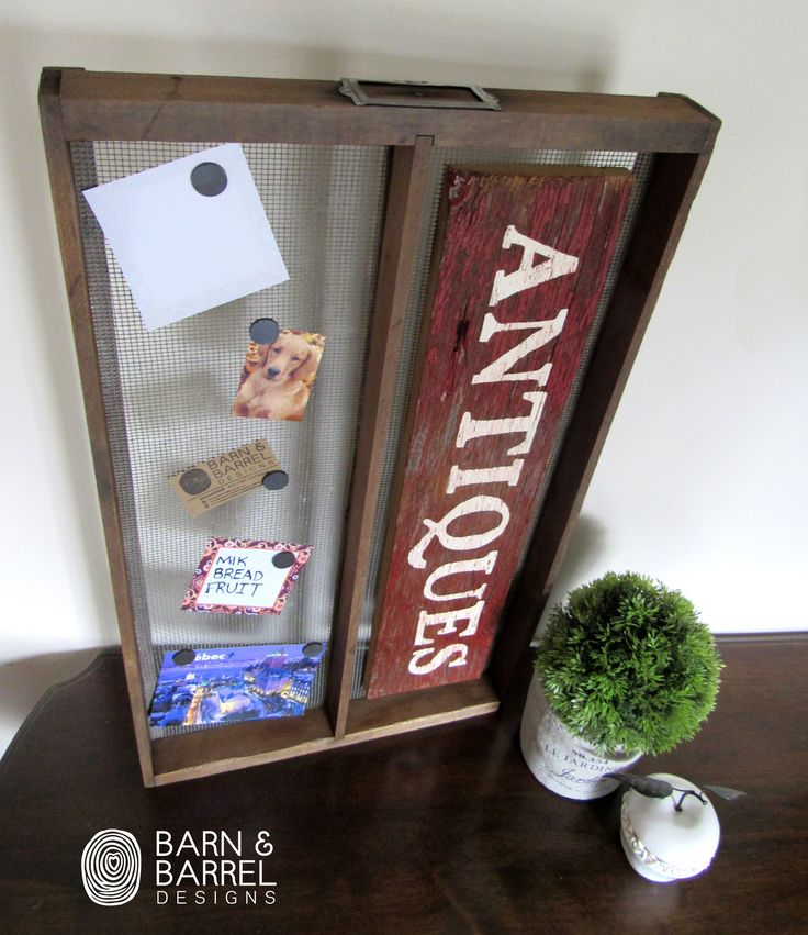 Beautiful Farm house style Message board created from a vintage soil sifter. This one of a kind piece has a red barn wood hand painted 'antique' sign on the right side. The frame has been cleaned, sanded and varathaned. The left is perfect for grocery reminders, messages, pictures, spice jar magnetics and many more ideas!