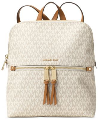 MICHAEL Michael Kors Rhea Medium Slim Backpack $258.00 Redefine off-duty chic with the modern Rhea backpack from MICHAEL Michael Kors, equipped with plenty of space for your tech, smartphone and other on-the-go must-haves.