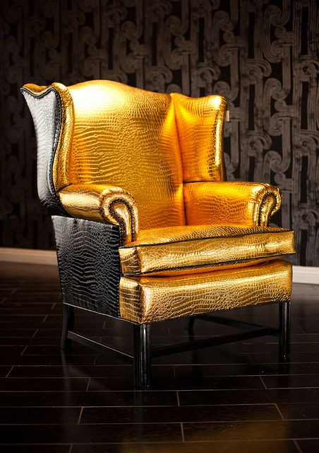 super glam wingback chair upholstered in gold and black croco and trimmed with black nailheads wingback chairs gold and interiors