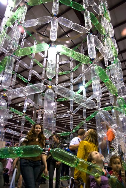 Soda #bottle #wave: 12 'x 12' x 25' tall recycled two-liter soda bottles, string, wood, steel, one electric motor.