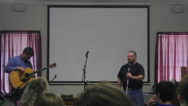 Greg McDougal singing at Hope Corral Cowboy Church.