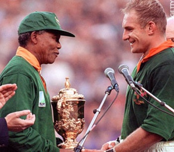 1995 Rugby World Cup Final. After spending 27 years in prison for standing up for what he believed in, Nelson Mandela was finally released in 1990. Soon after, apartheid in South Africa was finally ended and the 1995 Rugby World Cup became the first sporting event to take place in South Africa since it's end. In a touching moment, after South Africa emerged victorious in the Final, Nelson Mandela presented Francois Pienaar with the Webb Ellis Cup.