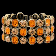 """Show your edgy side with """"Forever Amber"""" – a heroine from the 40s who threw caution to the wind and lived her life to the fullest.  Three rows of Swarovski's round and square cut amber crystal are spectacular, set in this unique bracelet finished in antique copper."""