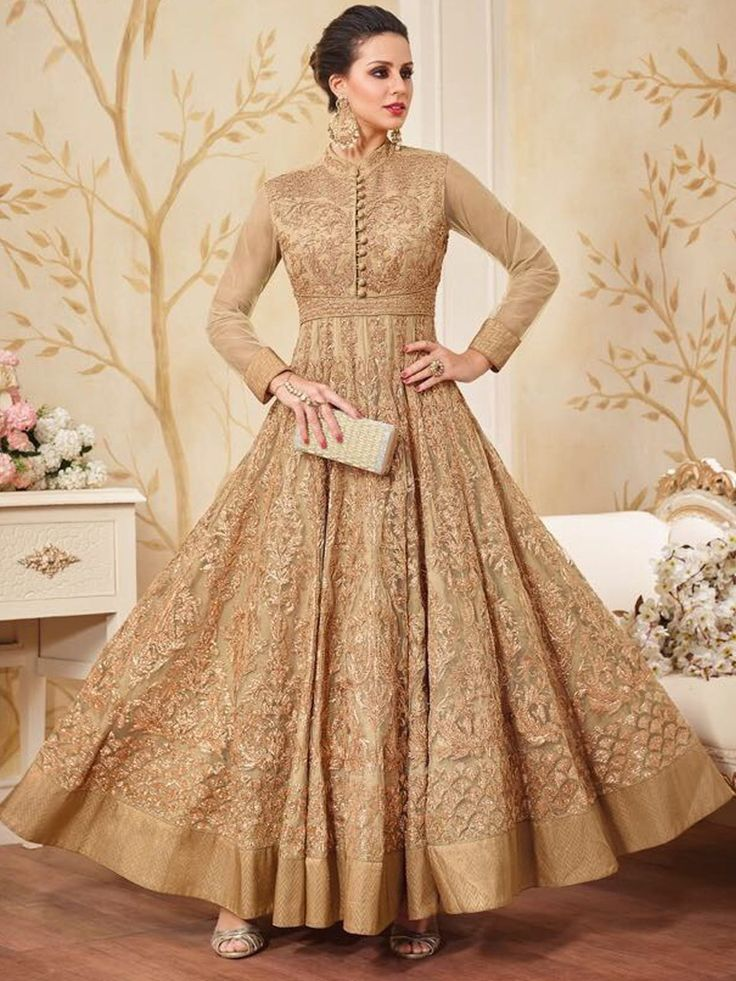 Endearing beige anarkali suit online which is crafted from net fabric with exclusive thread embroidery work. This stunning partywear anarkali suit comes with shantoon bottom and chiffon dupatta. #Inddus #SalwarKameez #WeddingAnarkaliSuits #PartywearAnarkaliSuits #IndianClothing #Sale #Discount #Offer #USA #UK #Mauritius #Australia #India #Malaysia #Singapore #Switzerland #NewZealand #FreeShipping