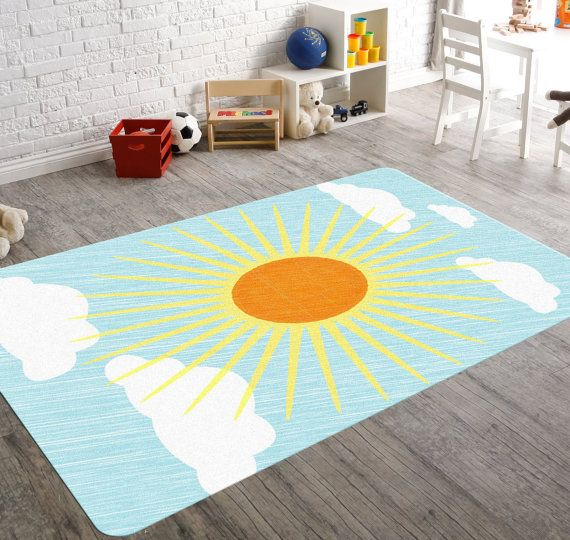 Make this colorful rug a part of your modern gender neutral nursery decor. A super cute yellow & blue Sun Nursery Rug!