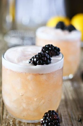 Blushing Whiskey Sour- 3 blackberries, 1 shot whiskey, 2 shots lemon syrup