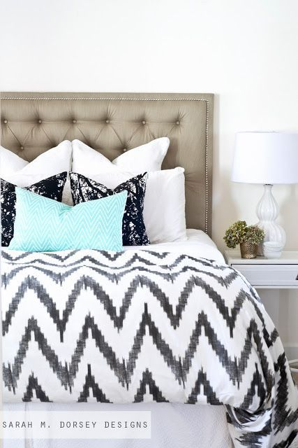 Mix and match prints and colors, like a bright pop of aqua with graphic chevron and anchor with a neutral like white Euro shams for a perfectly made bed.