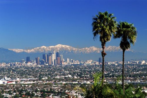 Los Angeles with snow-covered San Gabriel Mountains in the background