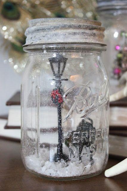 DIY Snow Globes: a mason jar, tiny train set figurines, fake snow and hot glue.
