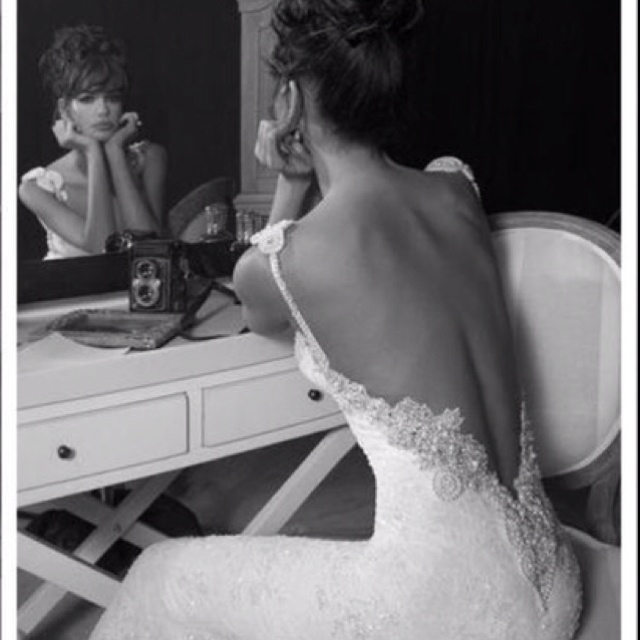 Backless wedding dress -- love the open back, I'm def. a sucker