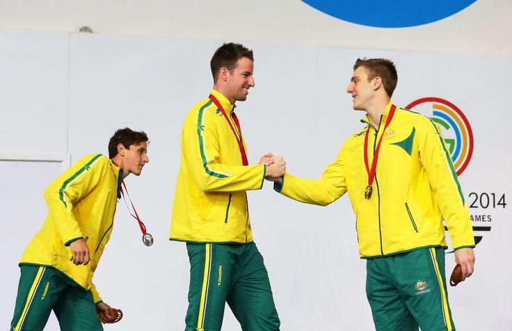 Gold medallist James Magnussen of Australia shakes hands with bronze medallist Tommaso D'Orsogna (R) of Australia as silver medallist Cameron McEvoy (L) of Australia