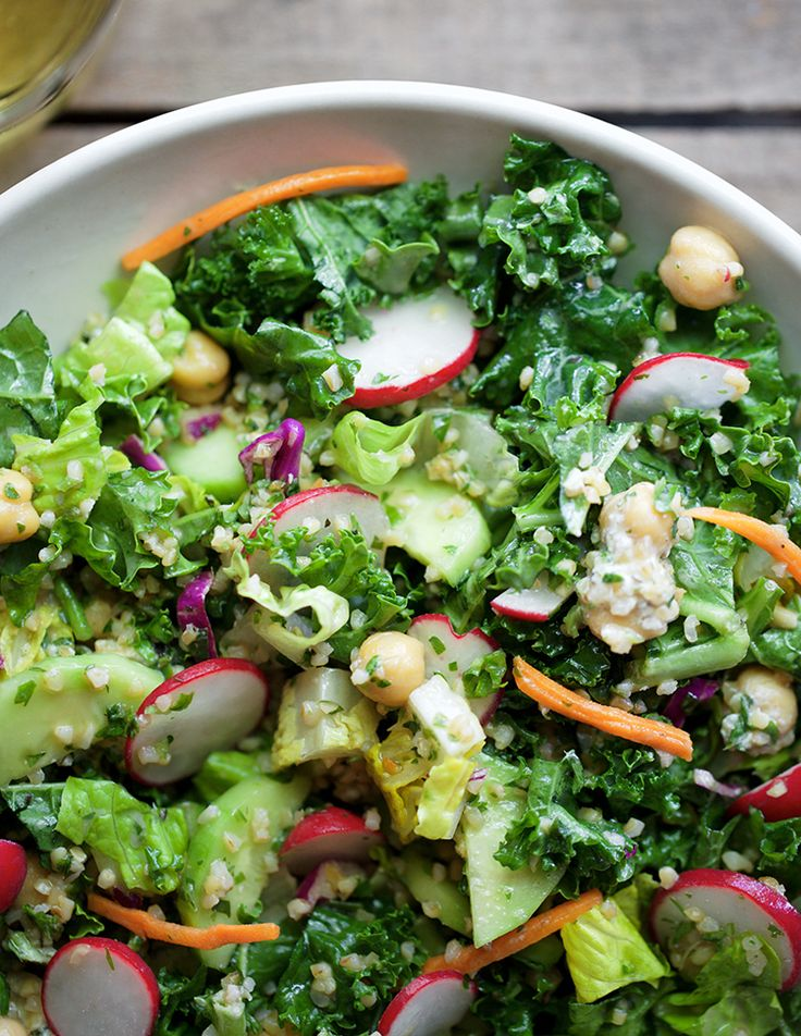 YUM! get this healthy, filling, and easy recipe for Kale Chickpea + Seed Salad with Miso Yogurt Vinaigrette on jojotastic.com (and save this pin for later!)