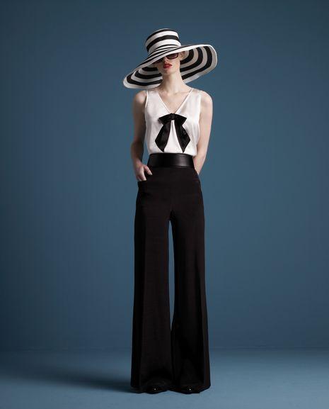 I need this Katherine Hepburn look!  I know I have the hat, the sunglasses, the slacks...  I need the top!