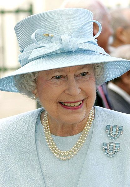 Queen Elizabeth wearing the Boucheron Aquamarine and Diamond-Clip Brooches given to her in 1944 as an eighteenth birthday present by her parents, King George VI and Queen Elizabeth.