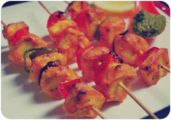 Paneer Tikka - A mouthwatering dish for the absolute food lovers! Skewers of marinated cottage cheese, capsicum and onions cooked in tandoor.  An authentic Indian variety from the house of Jai Ho Indian Restaurant!  #paneertikka #indianfood