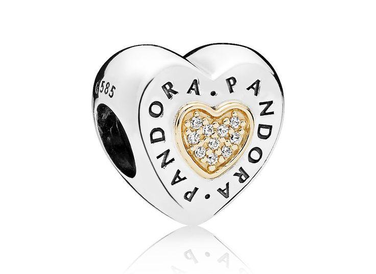 Pandora Bedel zilver-goud Pandora Logo 796233CZ.Hartvormige, sprankelende Pandora bedel. Op de buitenrand van de bedel staat het Pandora logo met daarbinnen een gouden hartje met pavégezette zirconiastenen. De bedel zal sprankelen aan jouw Pandora bedelarmband.   https://www.timefortrends.nl/sieraden/pandora/bedels.html