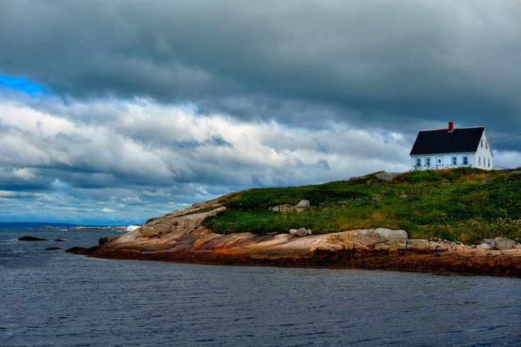 I can't get enough of this photo - the ocean, the rocks. Found near the Peggy's Point Lighthouse in Nova Scotia.
