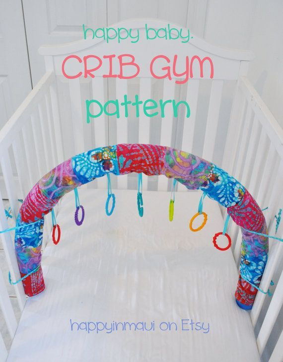 Crib Gym DIY (basically a covered pool noodle with tags for toys to hang from)- very cool (and CHEAP) idea!