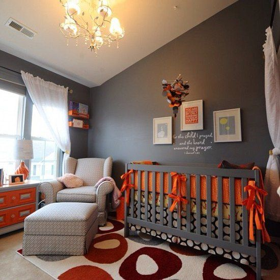 Bursting With Color : The bright orange accents of this room really stand out among the deep gray walls — the perfect nursery for a boy or girl
