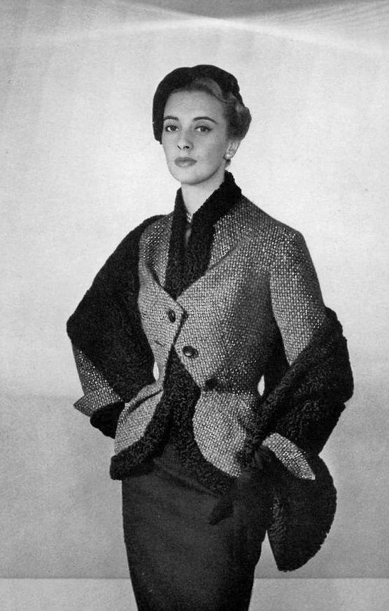 1953Marie-Thérèse in beige and black tweed jacket trimmed in astrakhan worn with astrakhan stole over black wool dress, by Pierre Balmain