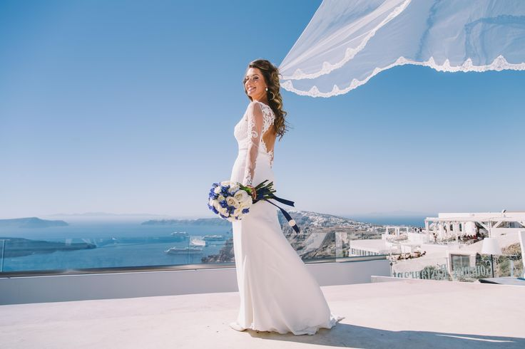#wedding #weddingphotoshoot #weddingphotographer #weddingideas #air #veil #oia #view #volcano #blue #sky #sea #little #islands #flowers #white #dress #moments #beautiful #bride #smile #happyday #oia #santorini #ios #folegandros #mikonos #miltoskaraiskakis