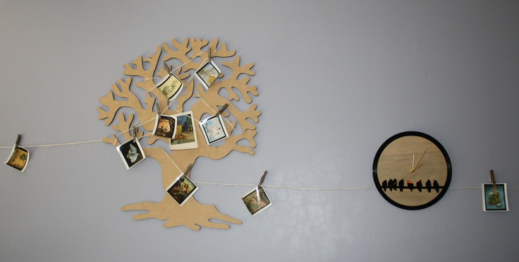 hard board tree and record clock with famous art works on