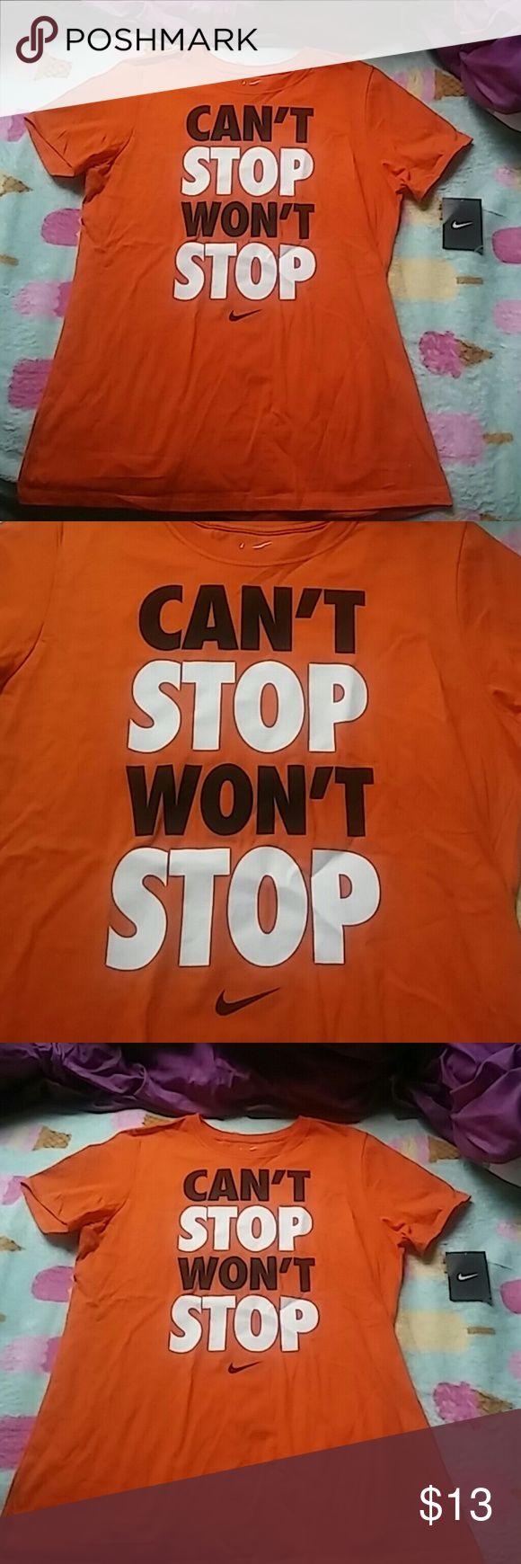 Nwt Nike orange shirt This is a new women's Nike orange can't stop won't stop shirt in a size large Nike Tops