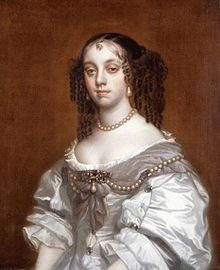 Catherine of Braganza, wife of King Charles II. She introduced England to drinking tea, already a popular custom among nobility in her native Portugal.  She and Charles produced no heirs, though he did father several illegitimate  children with mistresses.