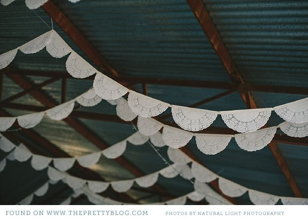 Paper doilie flags- DIY idea for wedding decor | Photography: Natural Light Photography