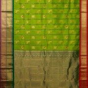 This resplendent gadwal silk is in pear green with stripes in pine green and animal bhuttas in gold zari and magenta thread work. the border is in grape purple, pine green and apple red along with …