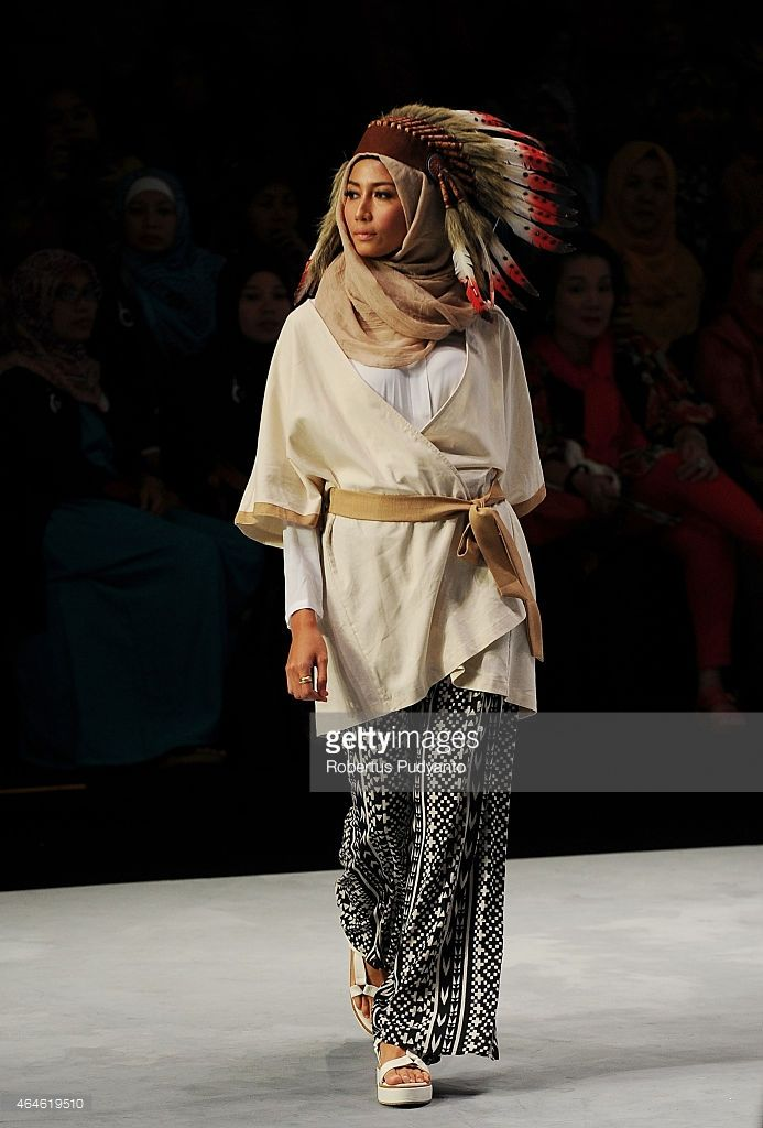 A model showcases designs by Jenahara on the runway in the Monochromatic Navajo show during Indonesia Fashion Week 2015 at Jakarta Convention Center on February 27, 2015 in Jakarta, Indonesia.