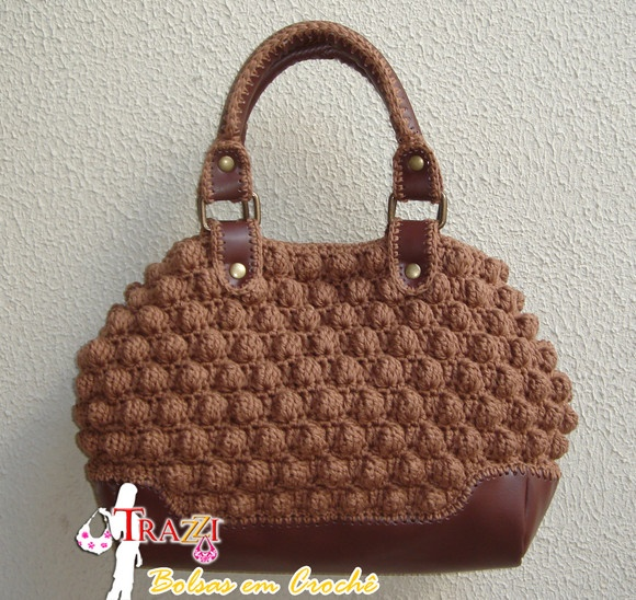I love to make crocheted bags but I rarely carry one. I'd carry this one.