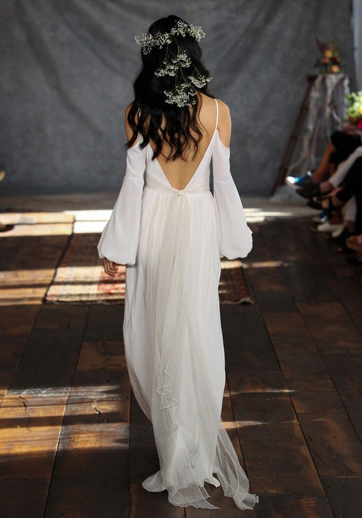 Oh how we love a boho bride! Dedicated to the queen of 70's bohemian glamour and style, the Bianca wedding gown is draped with ivory crepe in this flowing si...