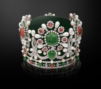 Empress Farah Pahlavi Crown by Van Cleef & Arpels.  Adorned with 1541 stones in total, including 105 pearls, 1469 diamonds, 36 emeralds, 34 rubies, 2 spinels, but most importantly, a spectacular 150-carat emerald set at the center. It weighed 4.3 pounds.