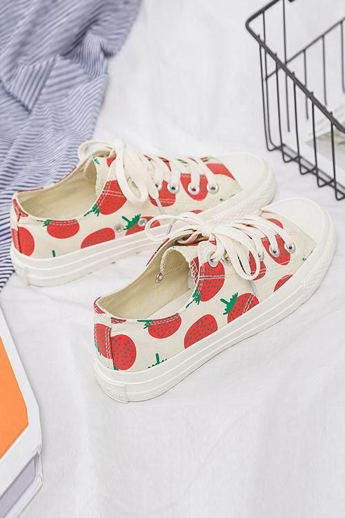 7422e992375 These strawberry shoes are sweet. We hand painted these white canvas  sneakers with red juicy strawberries all over. We then added ribbon shoe  laces to make ...