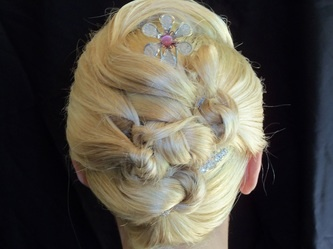 Golden blonde knotted updo hairstyle