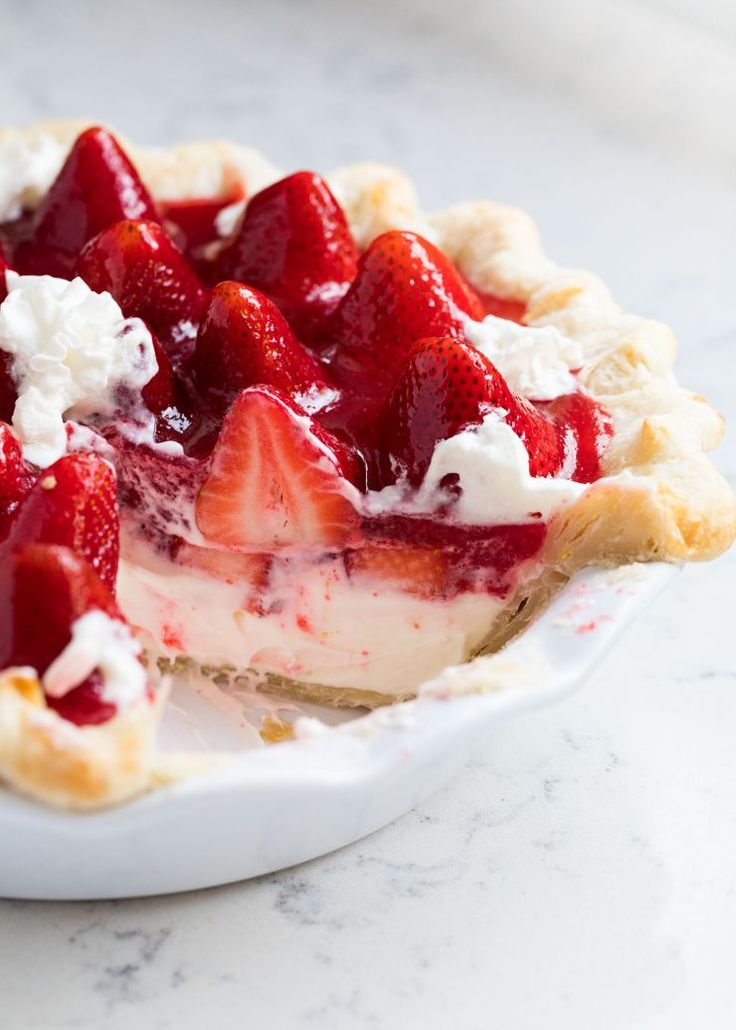 This homemade strawberry pie is made with a flaky crust, cheesecake filling and bursting with fresh strawberries. One of our favorite Spring desserts!